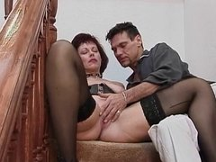 Mature babe in corset gets fucked on stairs