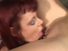 Mature redhead dildoing busty blonde in warehouse