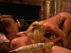 Blonde MILF sucks cock and gets fucked in living room