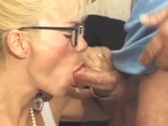 Sexy blonde gets down on knees and sucks a thick cock