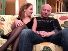 Sexy babe with nice round ass gives guy head on couch