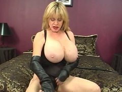 Mature milf with excellent body plays with a dildo and rubs her huge tits