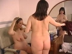 Pregnant brunette rubs pregnant blondes belly