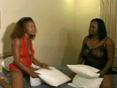 Thick black lesbian girls in lingerie lick pussy and fuck with a huge strap-on