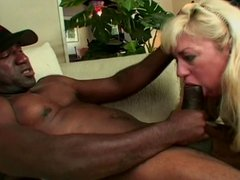Blonde mature white woman in lingerie loves to deep throat black dick