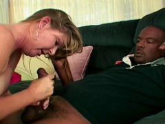 White mature woman with perky tits sucks on a giant black cock on her knees