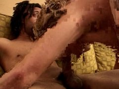 Guy holds bitch's head while she sucks his cock on a couch