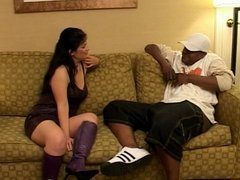 Mature brunette deep throats player's thick cock on a couch