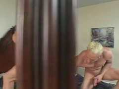 Horny blonde with a decent rack banged by 2 cocks