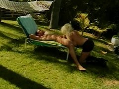 Busty blonde with heavy makeup takes dick in yard