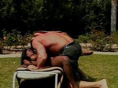 White stud and black chick do 69 on lawn chair then fucks