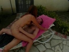 Horny brunette strips and sucks cock in back yard then fucks