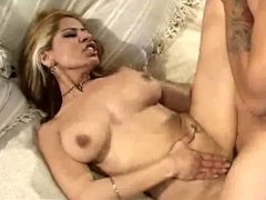 Busty babe sucks own toes while getting fucked on a couch