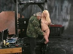 A dirty blonde slut is made to suck a dildo