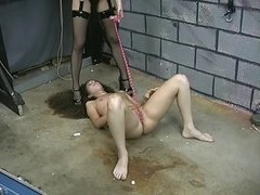 Slim bondaged brunette gets her pussy roped by long-haired dominatrix