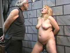 Chubby Candy in bondage gets tortured in dungeon