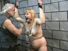 Fat bondaged blonde gets her mouth gagged and her floppy tits clamped