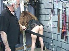 Hot brunette gets tide up in a dungen and spanked