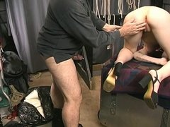 Cute little brunette is fucked doggy style by Master Len in the dungeon
