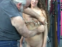 Cute young brunette slave girl has clips and clamps applied to her little tits