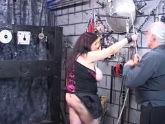 Dark-haired fat bitch restrained and humiliated in BDSM lair