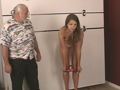 Arrested young brunette strips for old dude and show her opened pussy