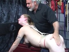 Cute young blonde school girl sucks on a dildo and gets spanked on her ass