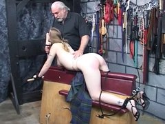 Trish gets restraint and bent over and dom spanks her hard  on her ass