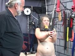 Chunky bdsm dyke restrained with ropes has glass box placed over her head