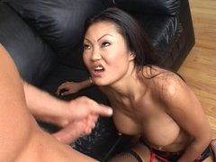 Sexy Asian unzips white guys pants and gives him a blow job