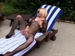 C-cup blonde in mesh masturbates outside and sucks two cocks together then fucks