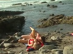 Lifeguard with huge breasts gets her juicy pussy licked on the beach