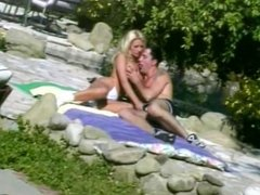 Blonde beauty wraps her lips around hung studs cock outdoors