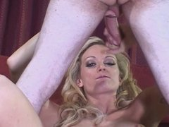 Tattooed blonde strips and strokes a hard cock