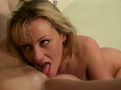 Hot lesbians take turns licking each other's perfect tits in the bath tub