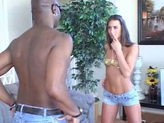 Black guy in sunglasses drills sexy young brunette on couch