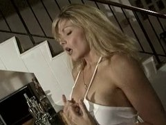 Blonde with great big tits masturbates alone by her wet bar