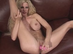 Beautiful blonde with amazing tits masturbates on her couch