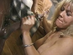 Kneeling c-cup blonde slut needs both hands to jerk off two dudes at once