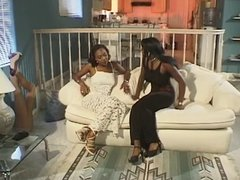 Two gorgeous black women share thick black dick on a couch