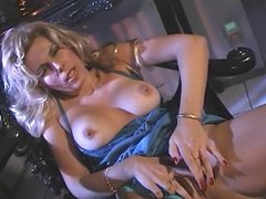 Hot blonde in lingerie fingers her tight pussy and rubs her tits
