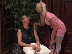 Blonde Valley Girl with great tits rides crippled dude's fat cock on wheelchair