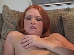 Hot young babe fingers her shaved twat on the couch