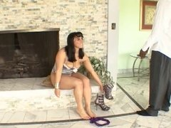 Lucky black stud gets head from brunette babe in front a fireplace