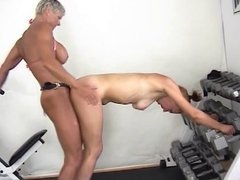 Body building big tit lesbian loves to strap on fuck younger girl