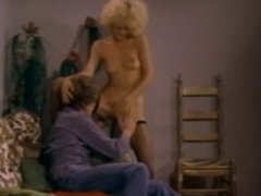 Blonde gets pussy licked by John Holmes