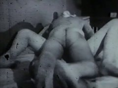 Retro scene with couple making love on bed