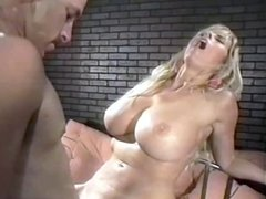 Blonde babe in blue with huge tits rides cock