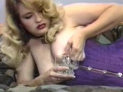 Cute blonde milf with lactating titties squeezes them into a glass and drinks it