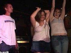 Wild girls enjoying a striptease show
